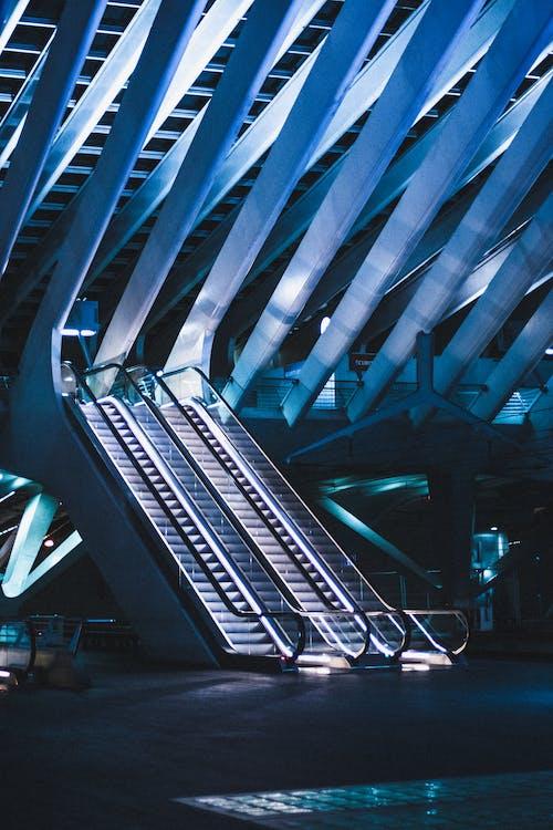 Escalator in stylish modern railway station