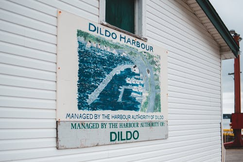 Signboard on cottage with location name Dildo Harbour
