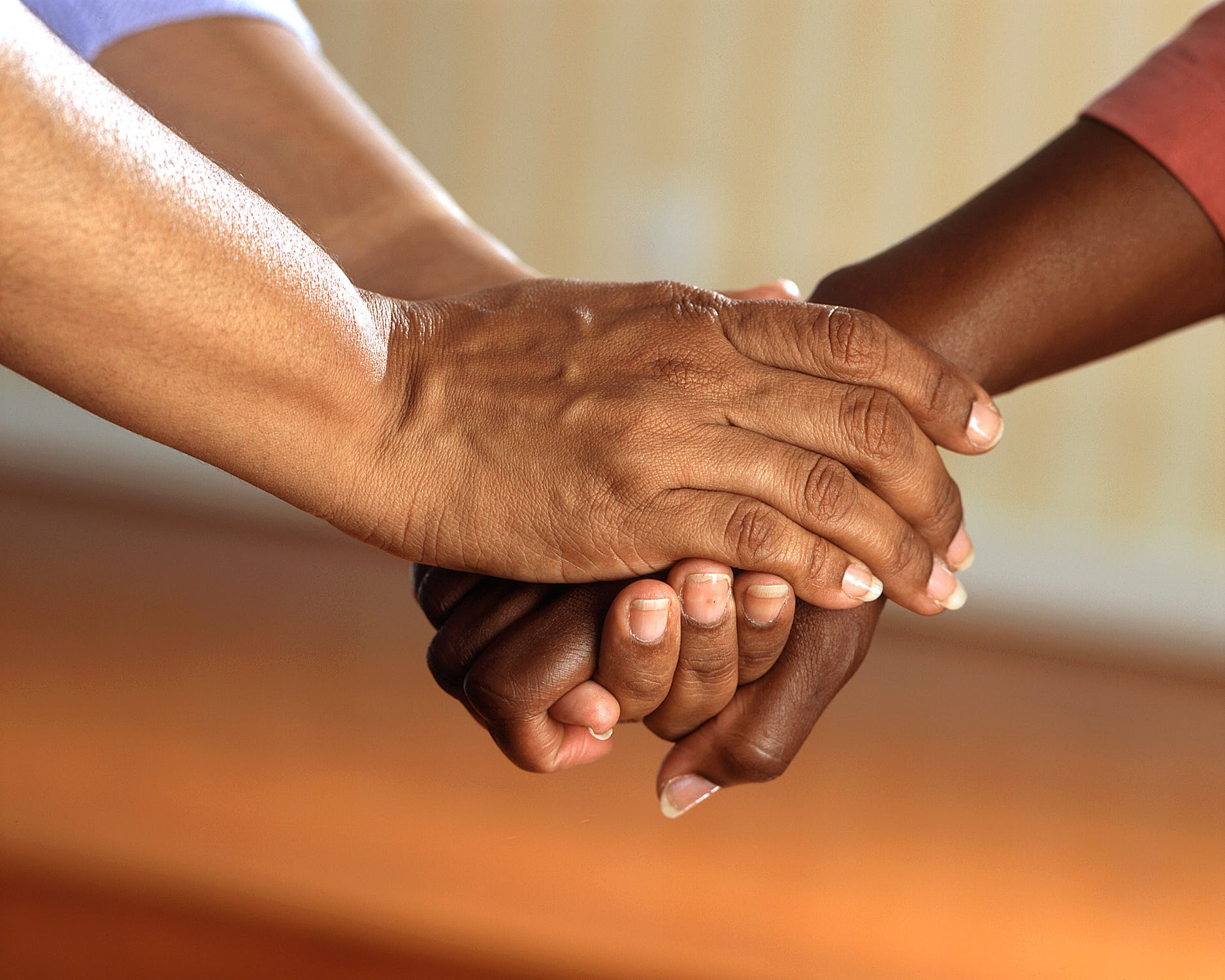 A close up of two hands holding. Photo by pexels user Pixabay. Used courtesy of pexels.com.