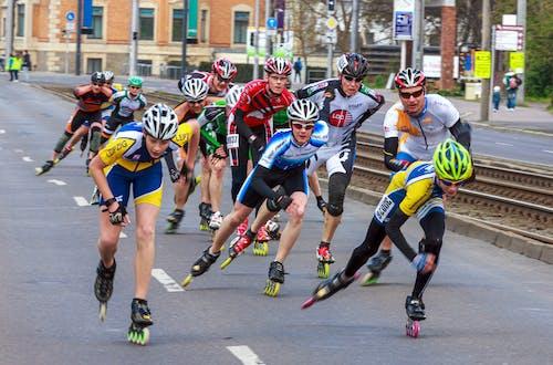 Men Rollerblading on Road