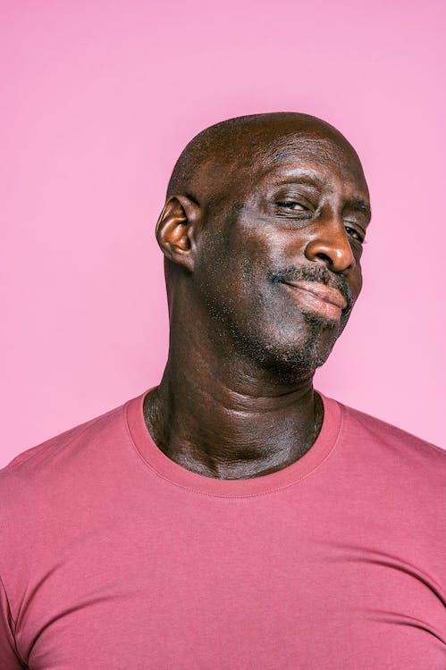 Bald Man Wearing a Pink T-shirt