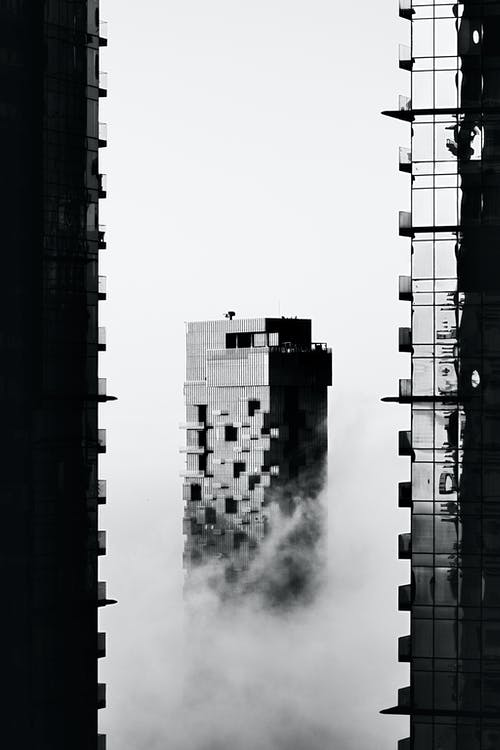 Grayscale Photo of Factory Smoke