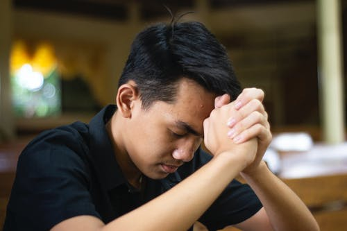 Close up of a Man Praying