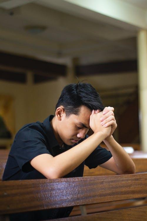 Man in Black Shirt Praying
