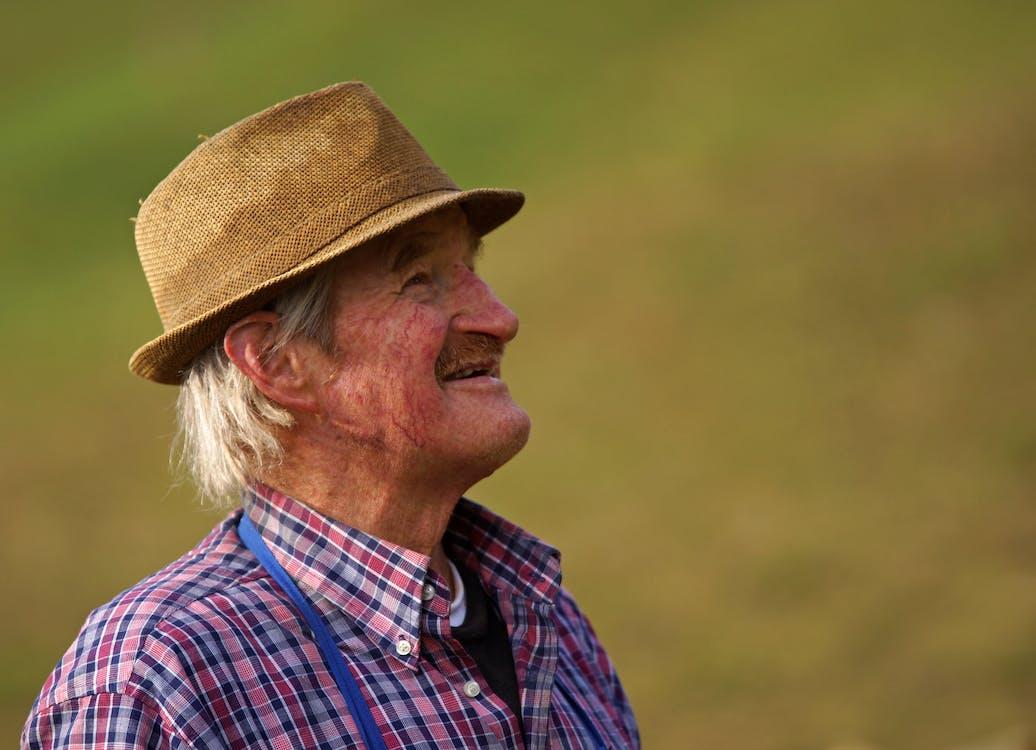 Man Wearing Brown Bucket Hat
