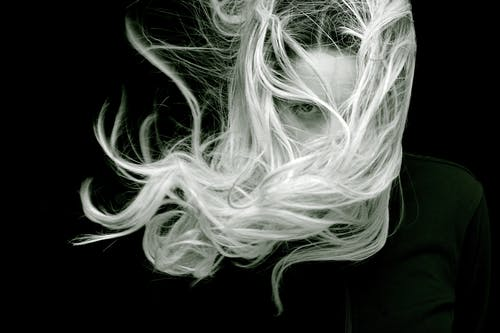 Woman Covered Face With Hair