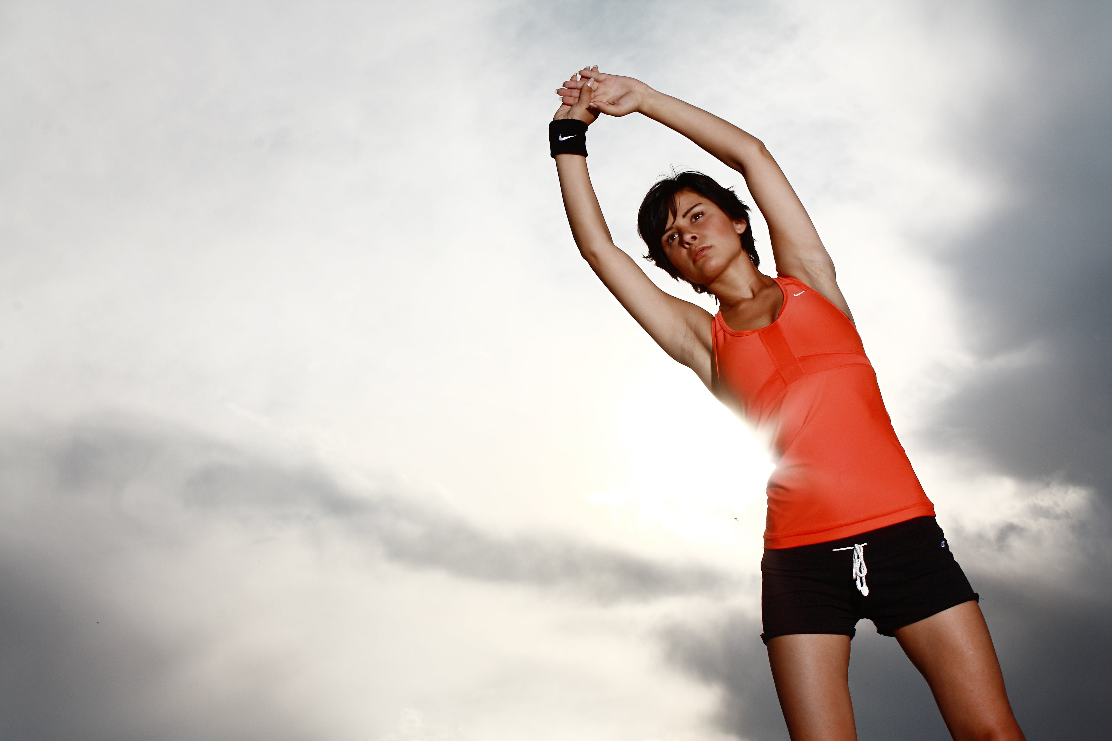 Woman Stretching With Her Hands on Air