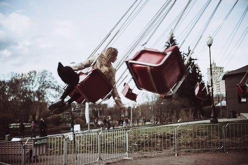 Gratis stockfoto met attractiepark, carnaval, iemand, meisje