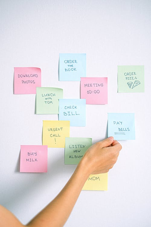 Person Holding Yellow Sticky Notes