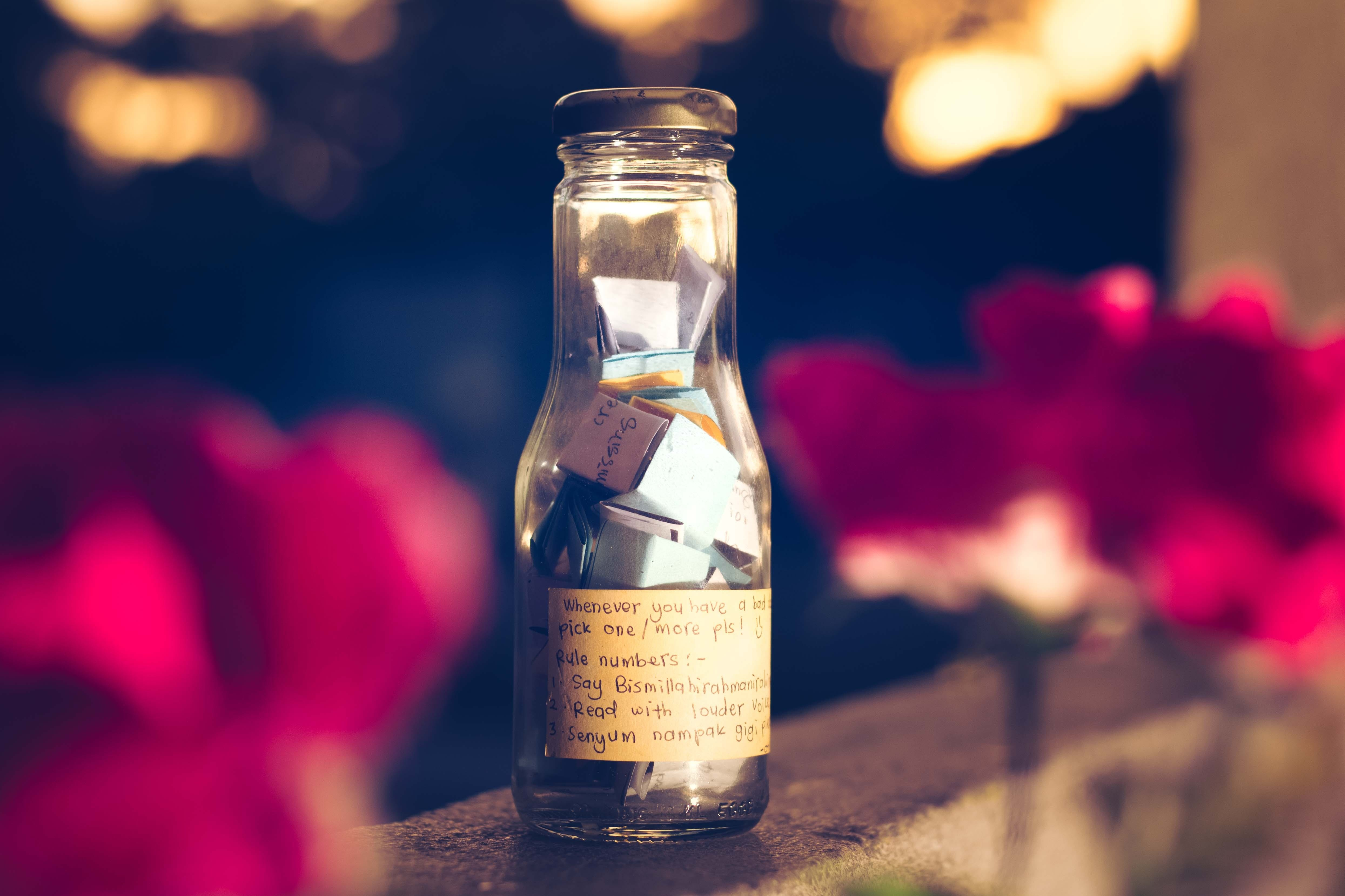 Shallow Focus Photography of Clear Glass Bottle