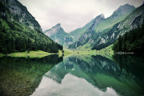 Green Mountains Beside Body of Water