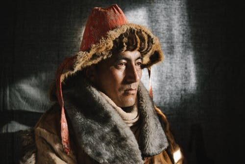 Man in Brown and White Fur Coat