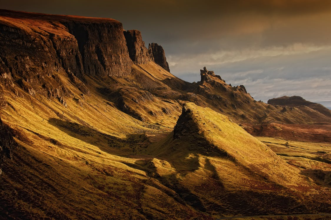 Brown Cliffs Under Gray Sky