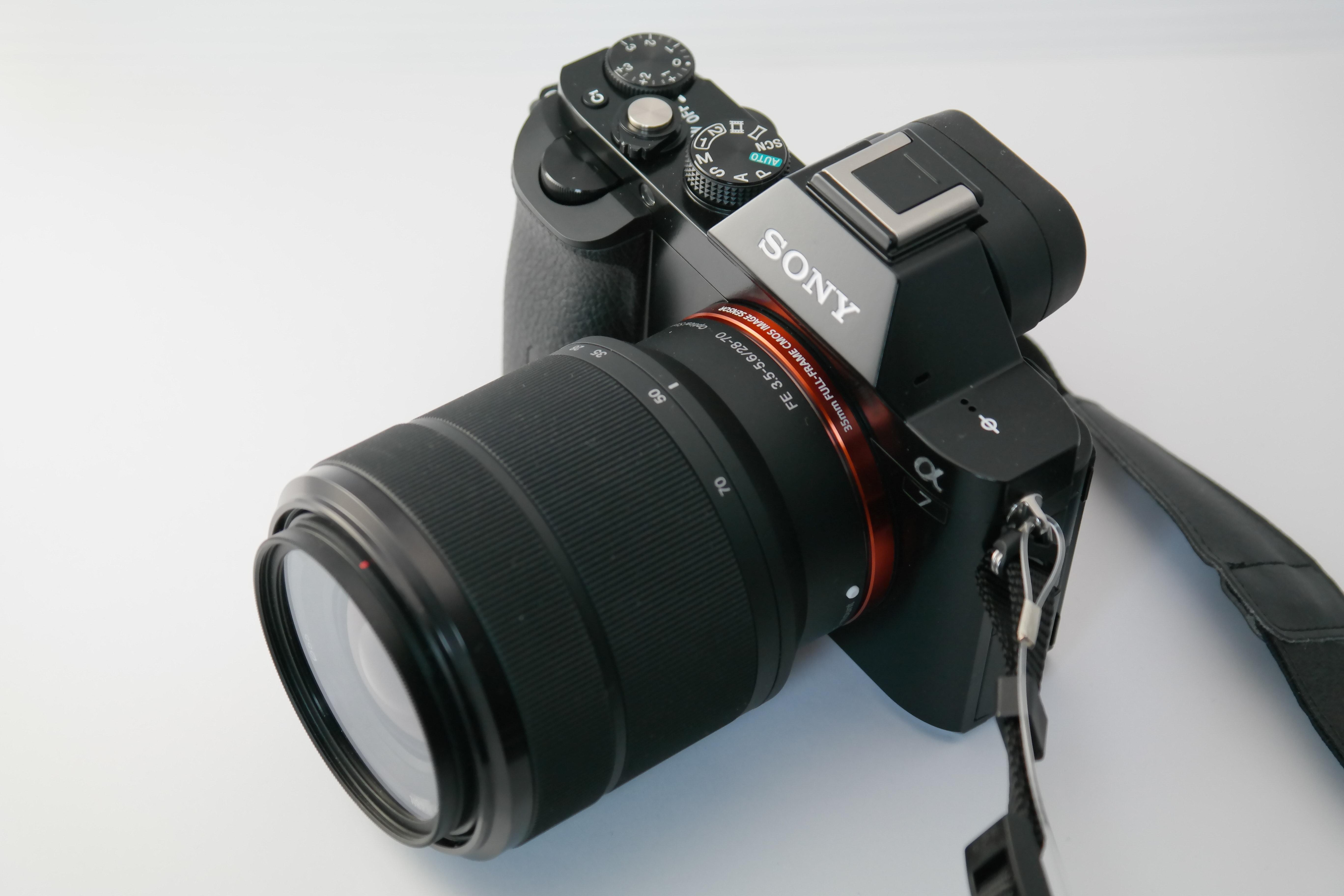 black sony dslr camera on white surface free stock photo