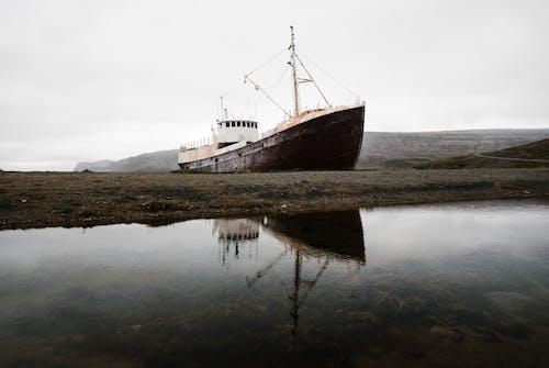 Brown and White Ship on Lake