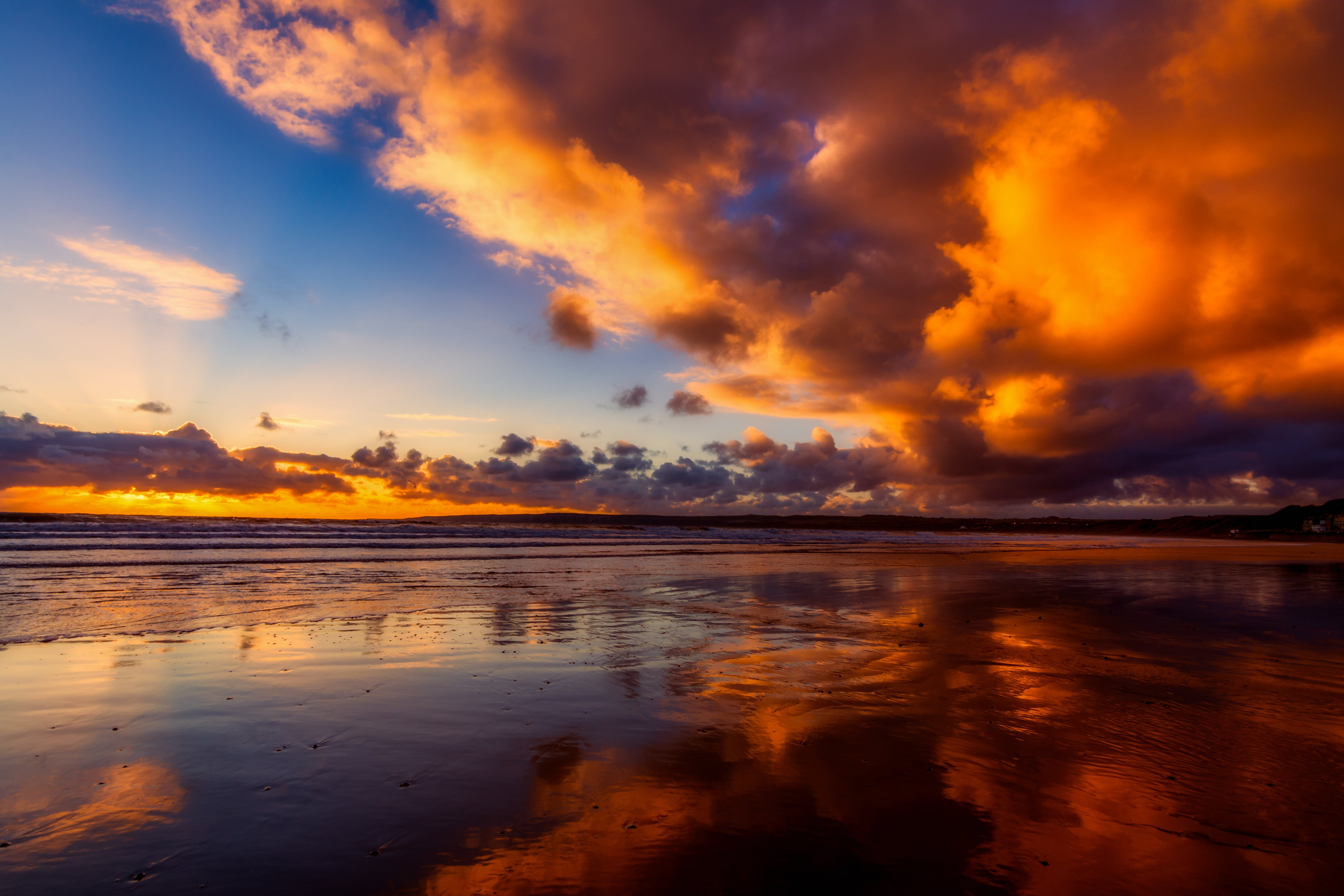 Orange Clouds Reflected on Body of Water