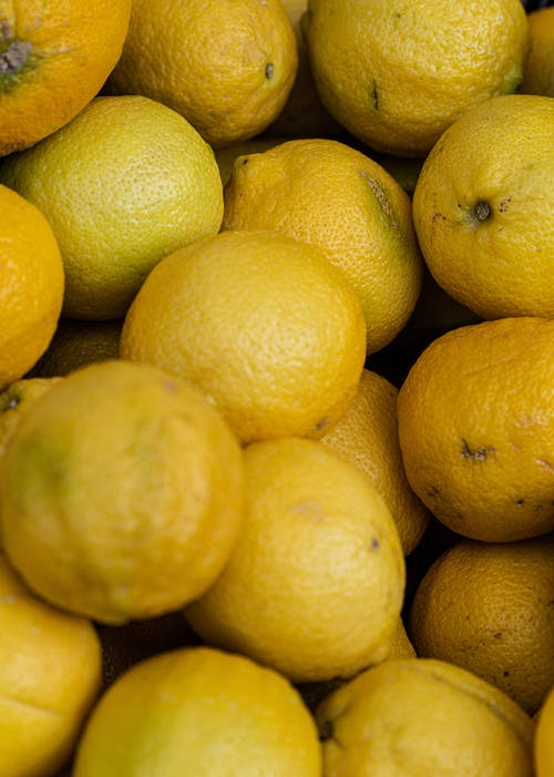 Yellow Citrus Fruits on White Ceramic Plate
