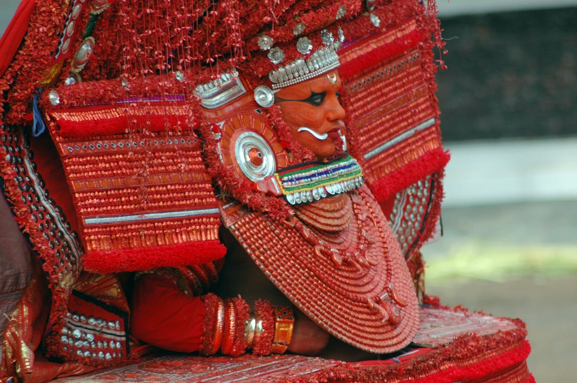 Red Buddha Figurine on Red Textile