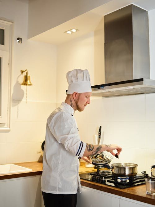 Chef in White Chef Uniform Cooking