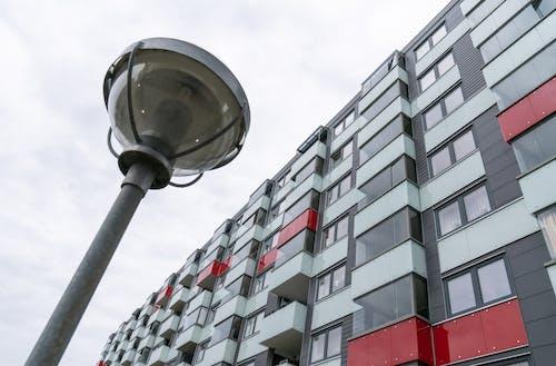 Free stock photo of apartment building, lamp, street light