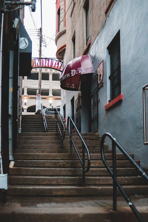 Stairway between old buildings on city street