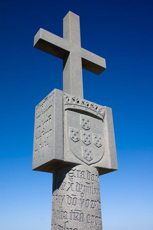 Gray Concrete Cross Under Blue Sky
