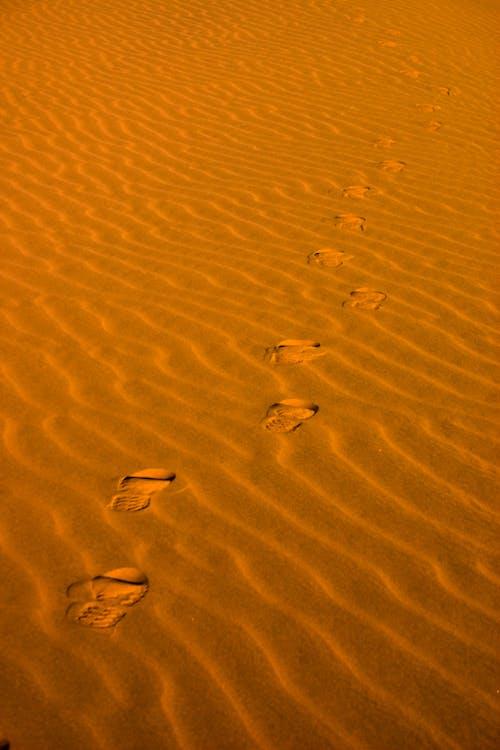 Foot Prints on Brown Sand