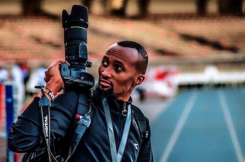 Free stock photo of a man holding, camera, kasarani stadium