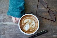 coffee, pen, sweater