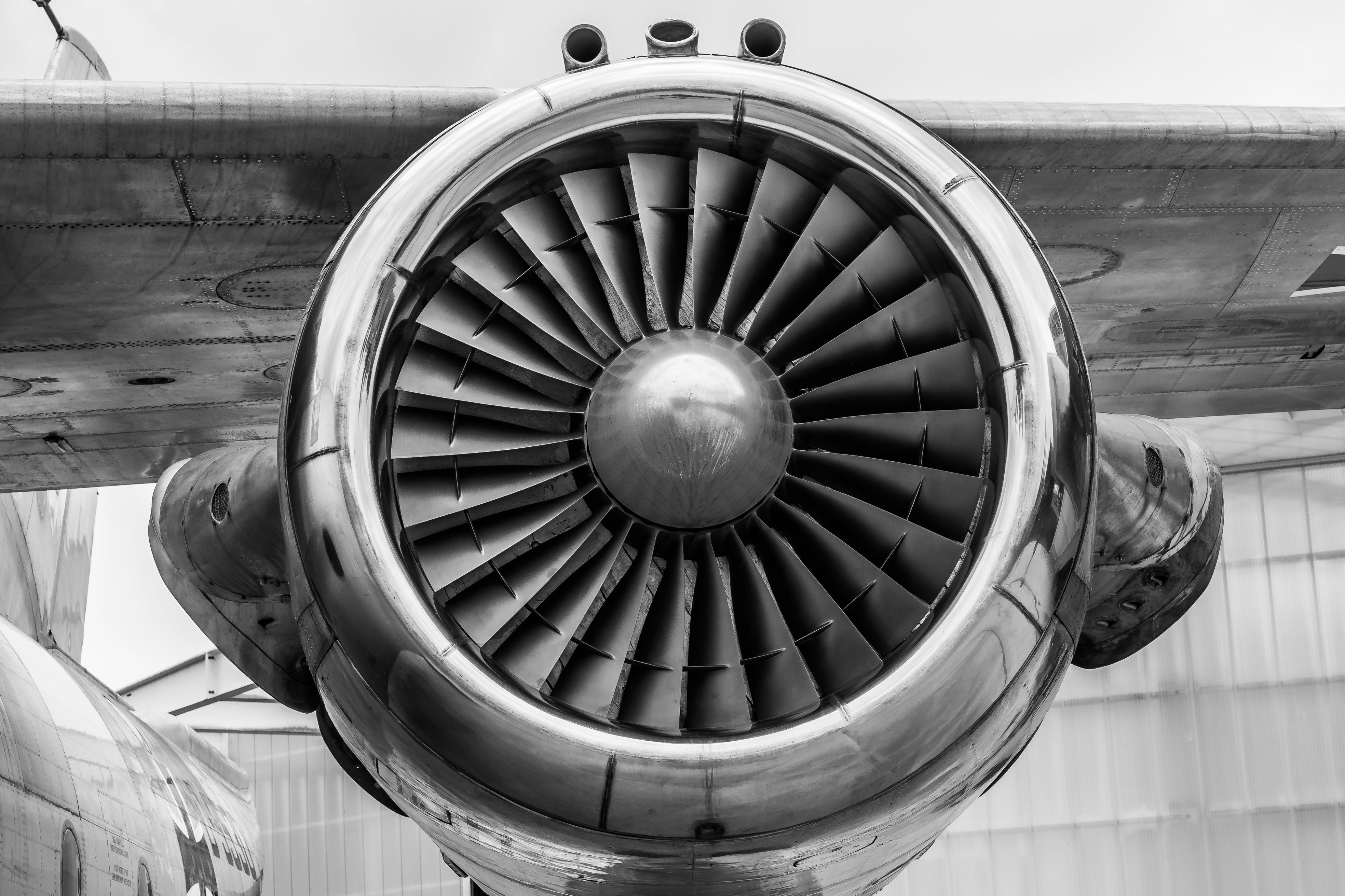 Grayscale Photography of Airliner Turbine