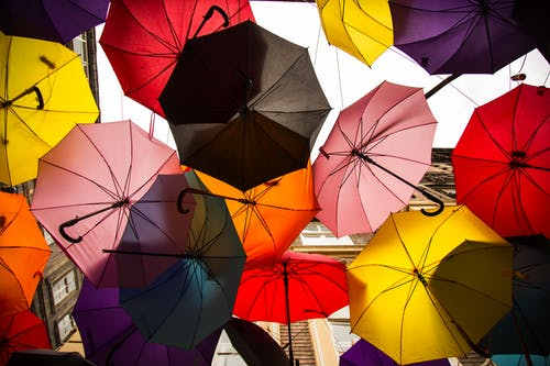 Low Angle Photo of Multi-colored Umbrella Roof