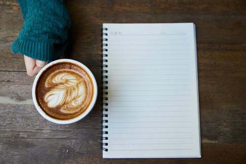 Black Rules Note Beside White Coffee Cup - Plan your day with a coffee in the morning is a great way to start the day