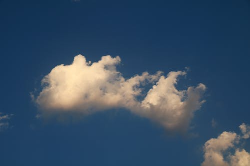 White clouds in blue sky in sunny day