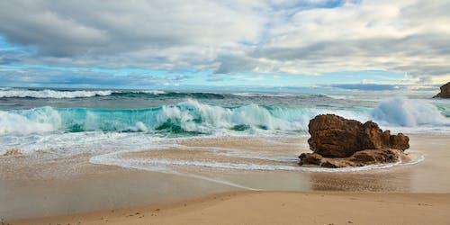 Foto profissional grátis de água, areia, beira-mar, enseada