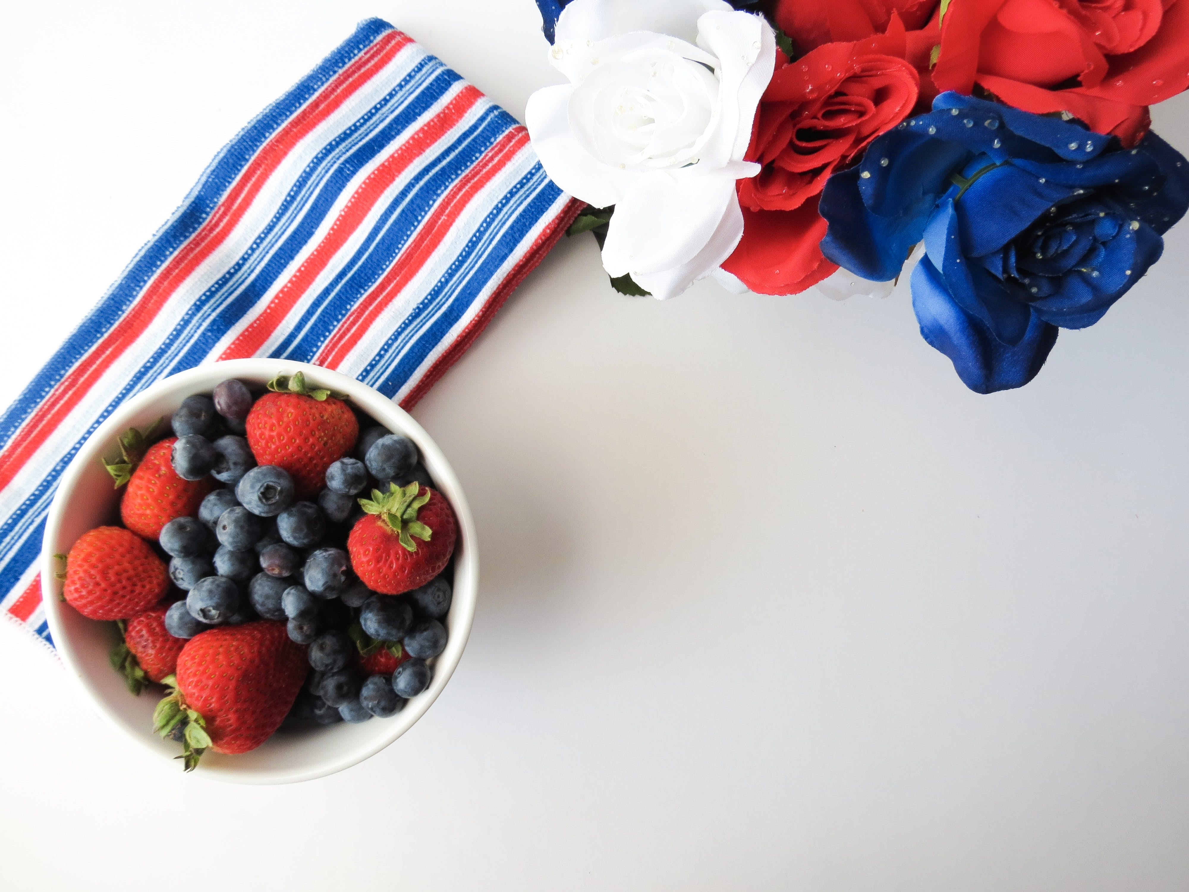 Blueberry and Strawberry Fruit Placed on Bowl