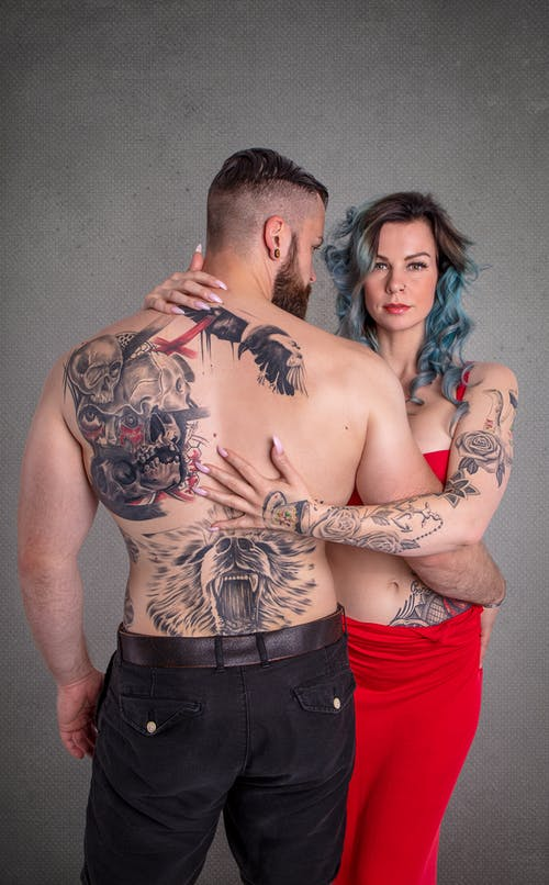Studio Shot of Tattoed Couple