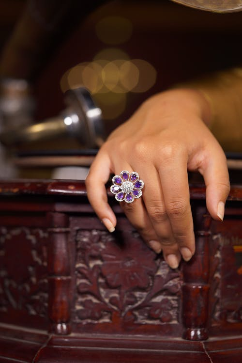 Woman showing luxury flower shaped ring