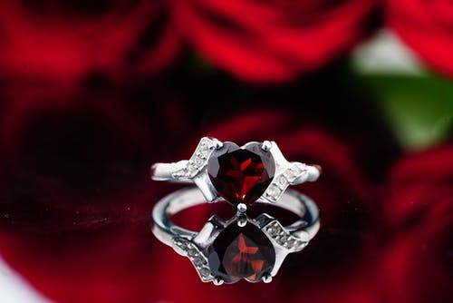 Elegant silver ring with red precious stone