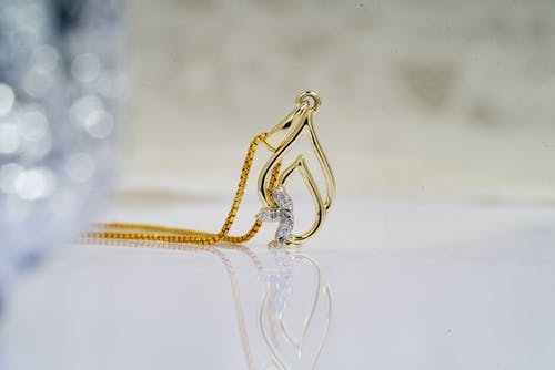 Foto d'estoc gratuïta de accessori, adorn, brillar, cadena