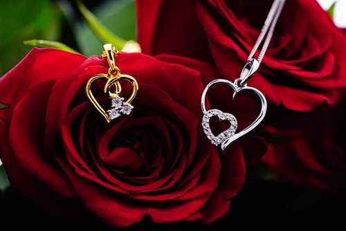 Red roses with shiny accessories on chains