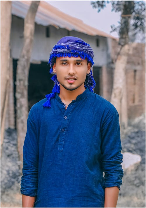 Confident ethnic man in traditional headdress