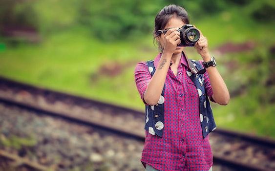 Free stock photo of person, woman, camera, taking photo