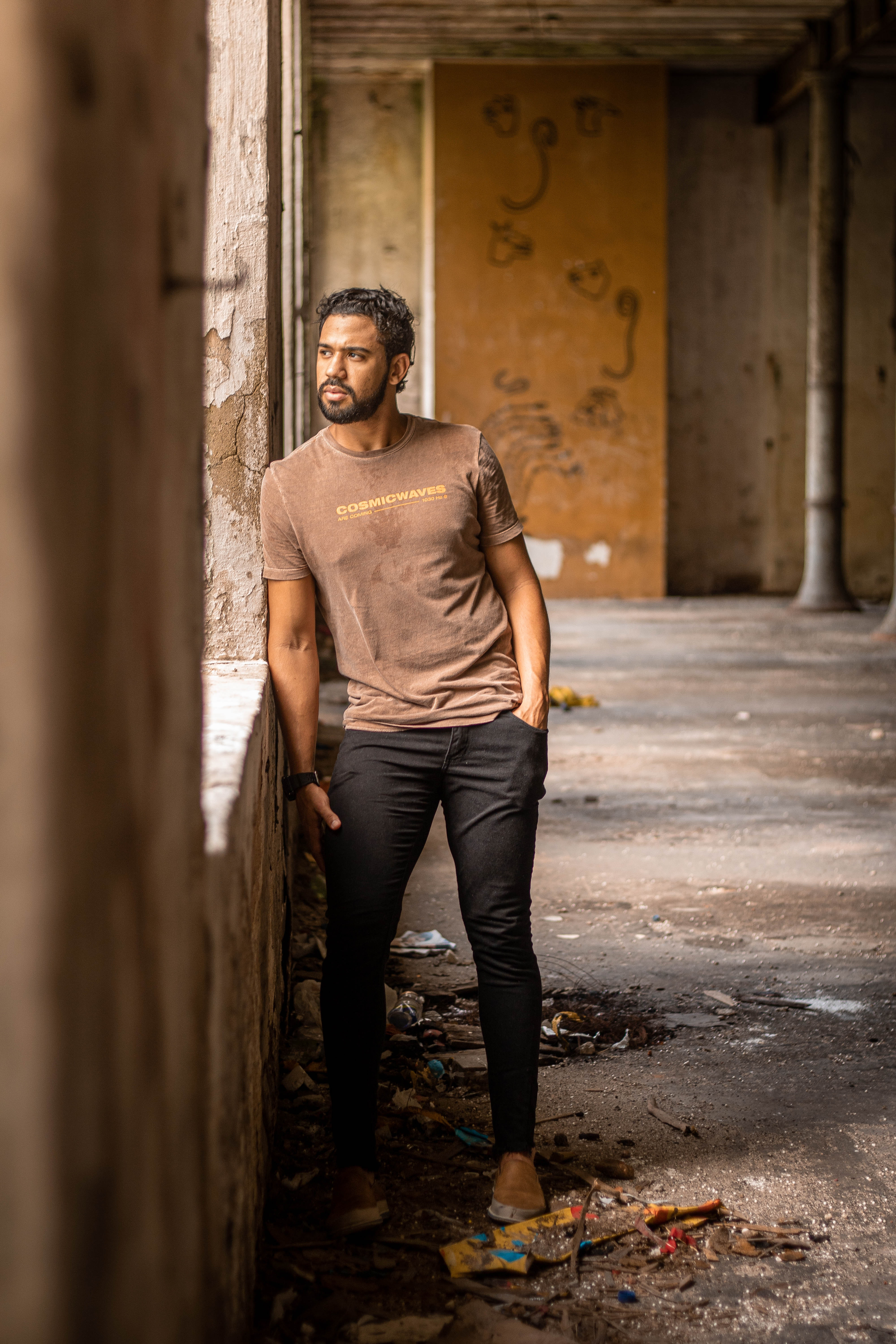 Ethnic Man Standing In Abandoned Building Free Stock Photo