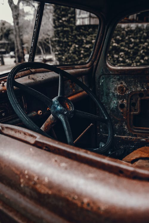 Black Steering Wheel in Grayscale Photography