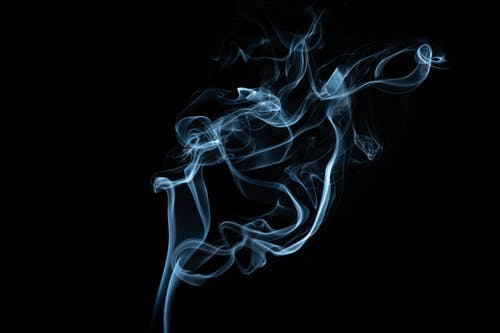 Abstract background of smoke flow in darkness