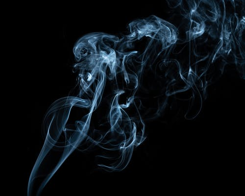 Fantastic smoke flow on black background in evening