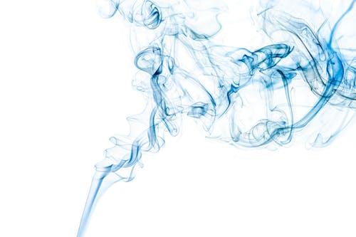 Bright blue wavy smoke on white background