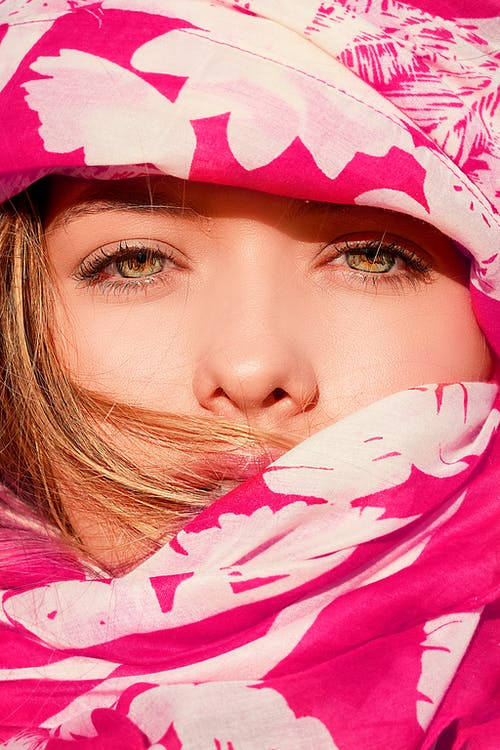 Woman Covering Her Face With Pink and White Floral Blanket