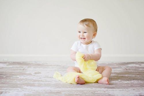 Toddler Sitting While Smiling
