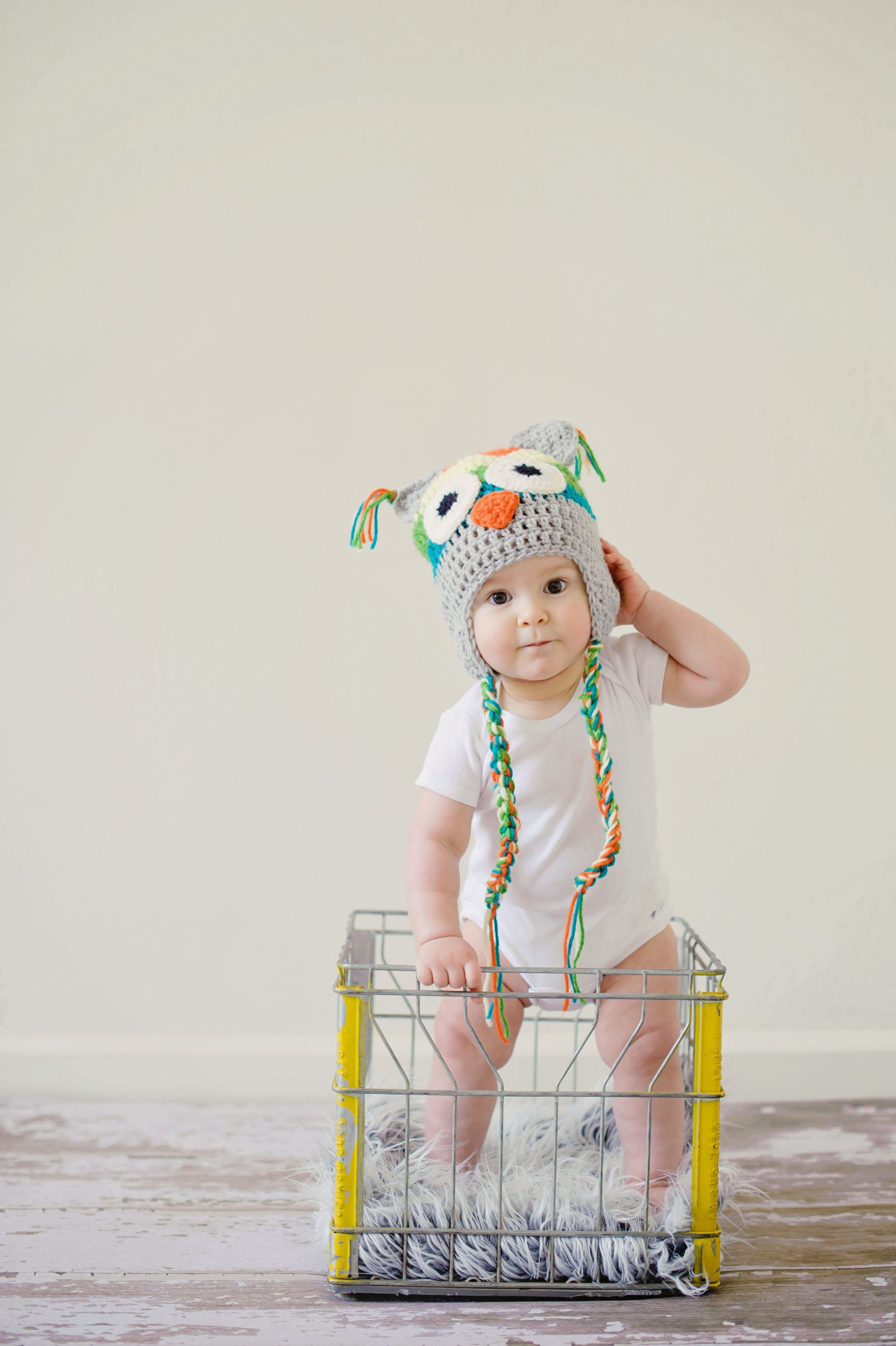 Toddler Standing on Basket